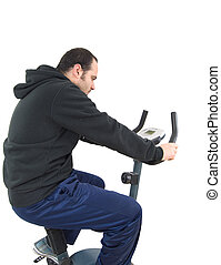Young man on stationary training bicycle