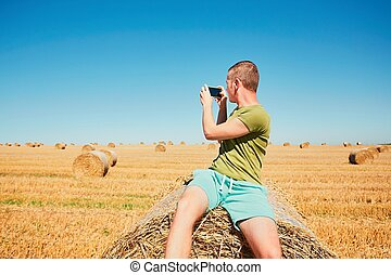Young man on the cornfield