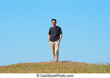 Young man on the grass field