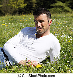 young man on the grass in a park