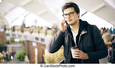 Young man on the phone at a farmer s market