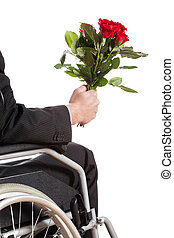 Young man on wheelchair waiting for his girlfirend