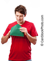 Young man opening letter