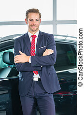 Young man or auto dealer in car dealership - Seller or car...