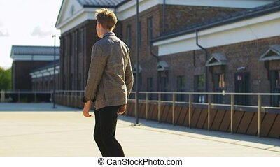 young man or teenage boy on skateboard on roof top - people ...