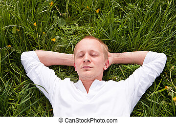 young man outdoor in summer in nature happy