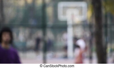 Young man play basketball streetball sport game walk toward camera