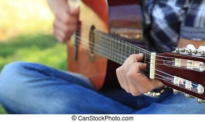 young man play guitar