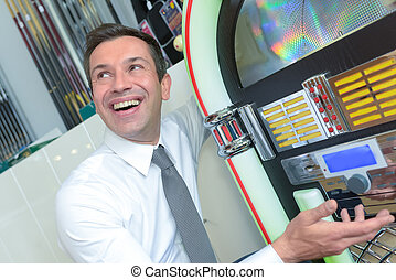 young man playing a slot machine