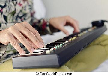 young man playing an electronic keyboard
