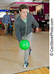 young man playing bowling