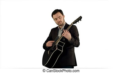 Young man playing guitar on white background isolated