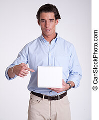 Young man pointing at box