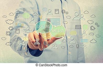 Young man pointing at social media concepts