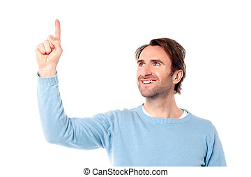 Young man pointing at something