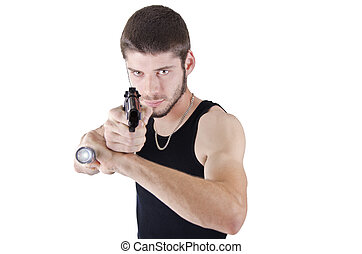 Young man pointing gun