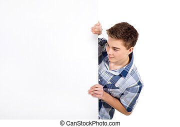 young man pointing to blank space