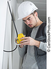 Young man pondering how to connect switch