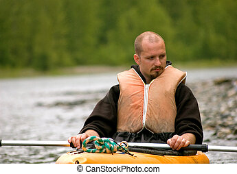 Young Man Pondering in Kayak
