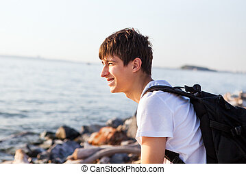 Young Man Portrait - Cheerful Young Man at the Seaside