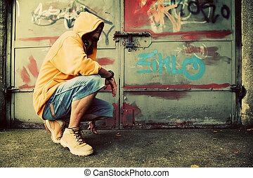 Young man portrait on graffiti grunge wall - Young man...