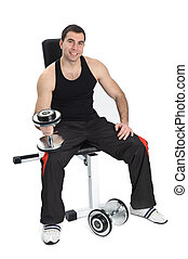 young man posing with dumbbells