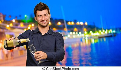 Young Man Pouring Champagne