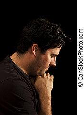 Young man prays
