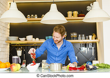 Young man preparing healthy food