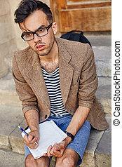 young man preparing to write down ideas