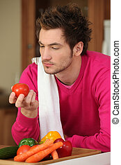 Young man preparing vegetables