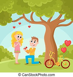 Young man proposing to pretty girl in park