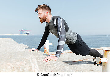 Young man pushed near the sea