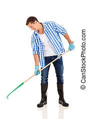young man raking