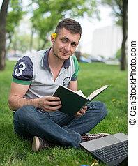 Young man reading Bible