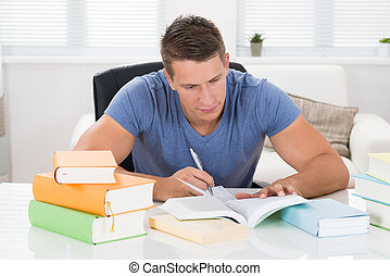 Young Man Reading Books