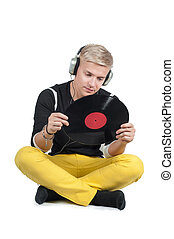 Young man reading from vinyl record