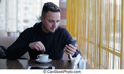 Young man reading the news on your phone internet