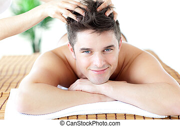 Young man receiving a head massage