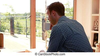 Young man relaxing having coffee
