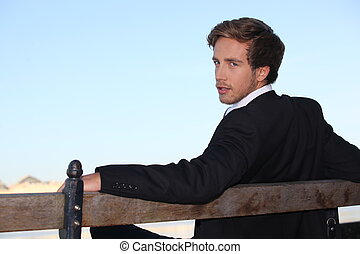 Young man relaxing on a bench