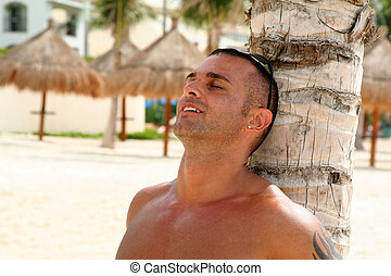 Young Man Relaxing on Beach