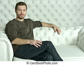 young man relaxing  on sofa