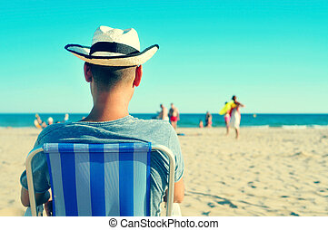 young man relaxing on the beach