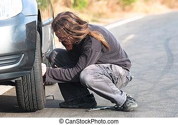 Young man repairing car outdoors