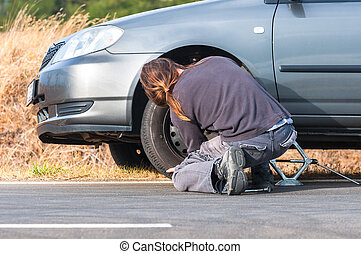 Young man repairing car outdoors