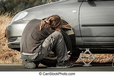 Young man repairing the car