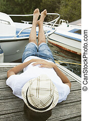 young man resting on the boat