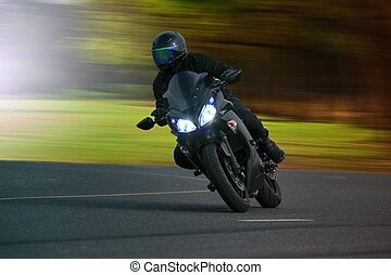 young man riding big bike motorcycle on asphalt high way against beautiful blurry background use for biker traveling and journey theme
