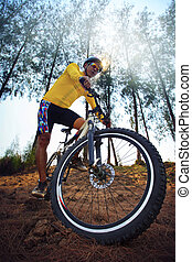 young man riding mountain bike mtb in jungle track use for...